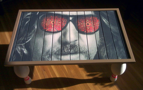 the dude's face on a table; finally