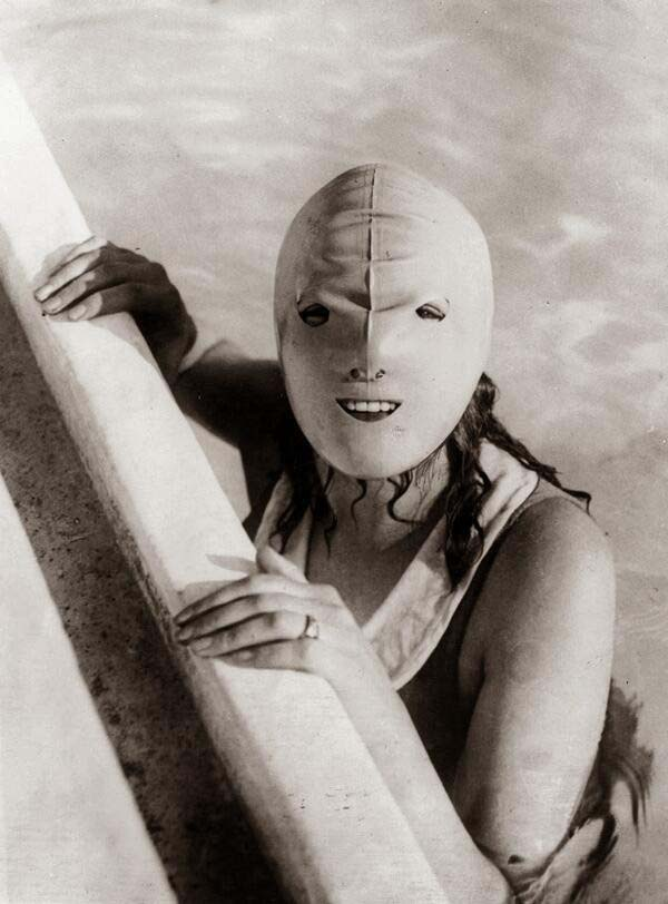 13. A full-faced swimming mask that was to help protect women's skin from the sun (1920s).