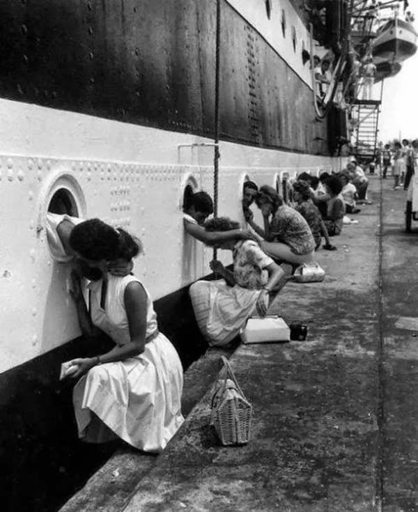 26. WWII soldiers get their last kiss before being deployed (1940s).
