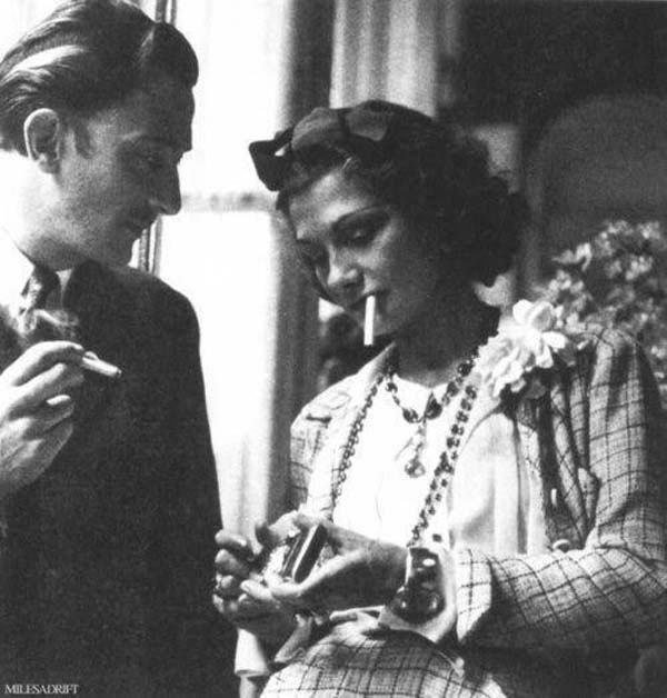 23. Salvador Dali and Coco Chanel sharing a smoke break (1938).