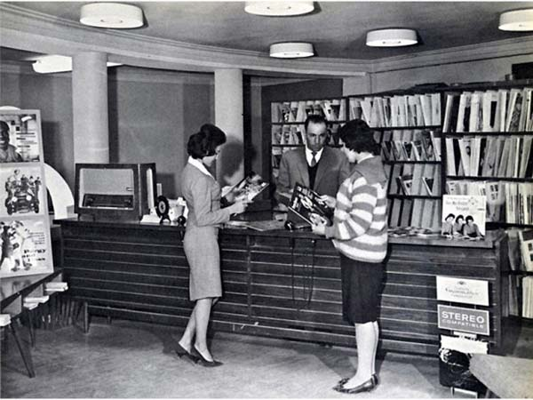 33. Afghan women, casually dressed, use a public library before the Taliban rule (1950s).