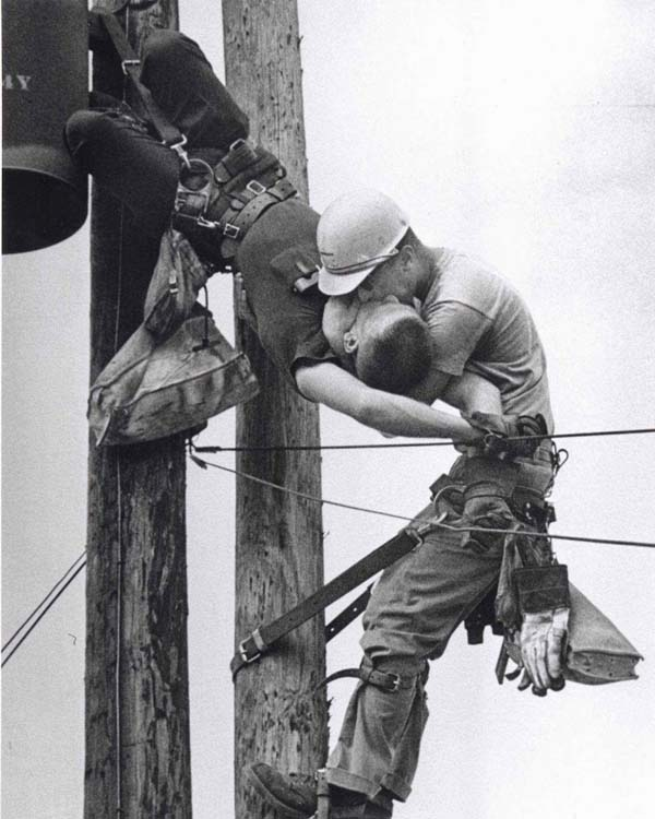 "42. A dramatic photo of a utility worker receiving CPR after being electrocuted, ""The Kiss Of Life"" (1967)."