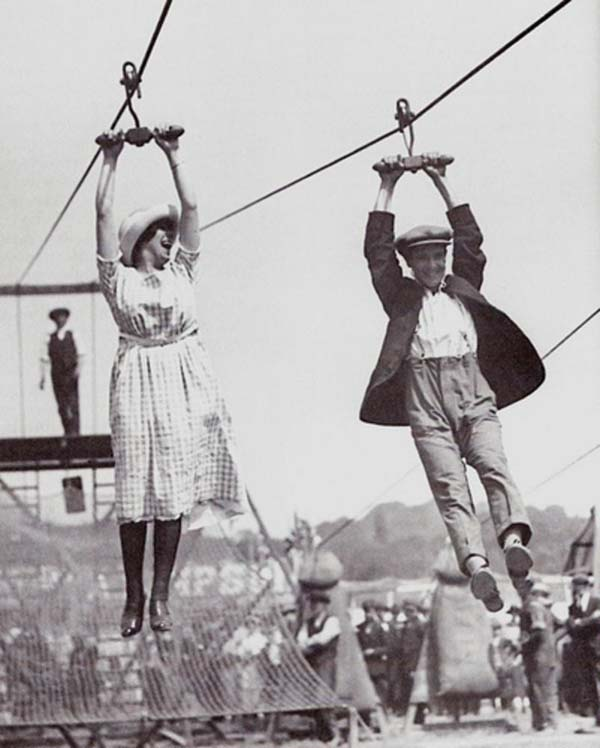 11. A couple enjoys an old-fashioned zipline at a fair (1923).