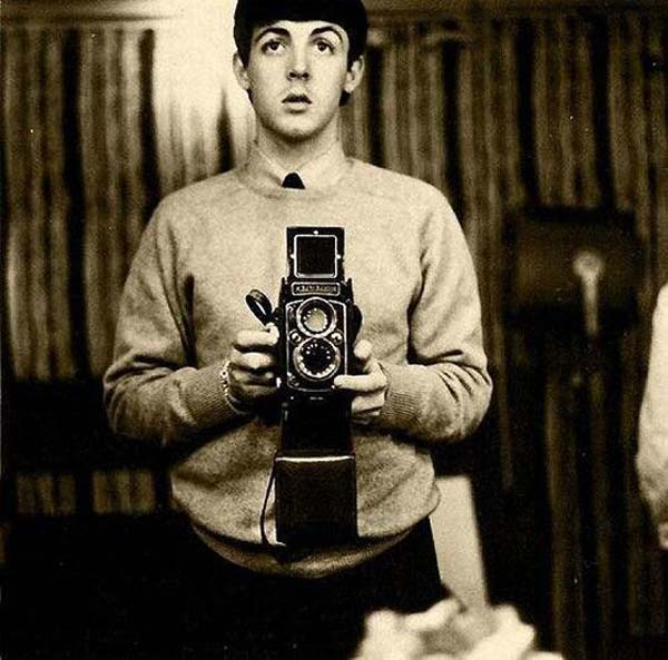 34. Paul McCartney takes a mirror selfie (1959).