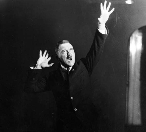 14. Adolf Hitler rehearsing his speeches in front of a mirror (1925).