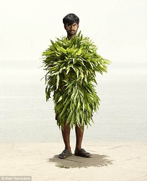 Hidden: This man appears to be almost completely covered with palm fronds
