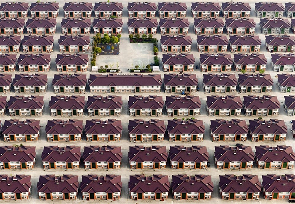 Polish photographer Kacper Kowalski received an award for this hypnotic suburban landscape image that almost looks like an optical illusion