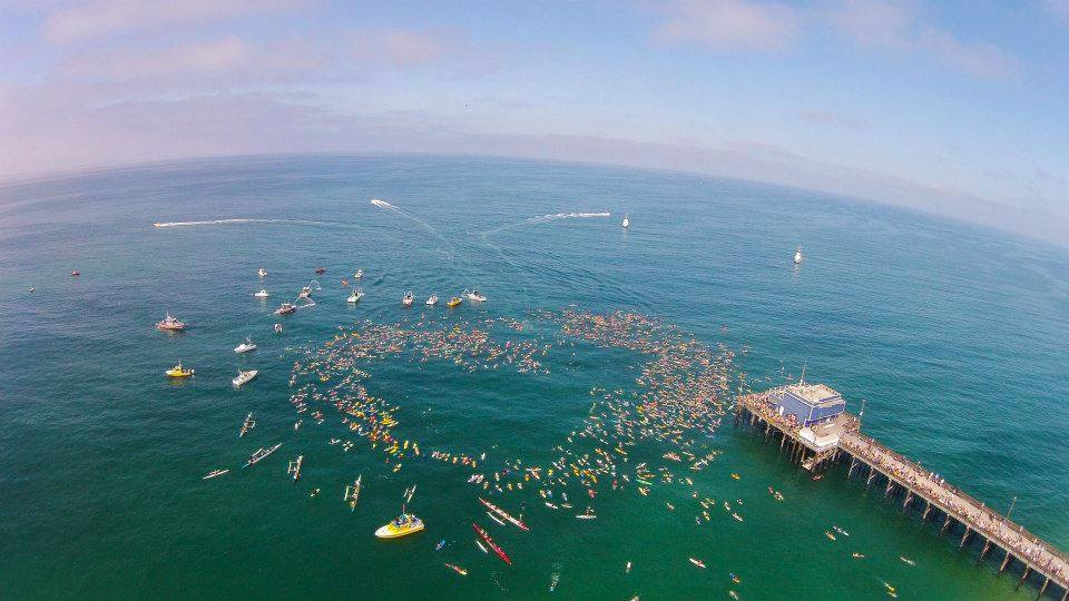 Yesterday, thousands of people showed up for a memorial paddle out to Honor Newport Beach Lifeguard Ben Carlson, Who Drowned Saving Swimmer