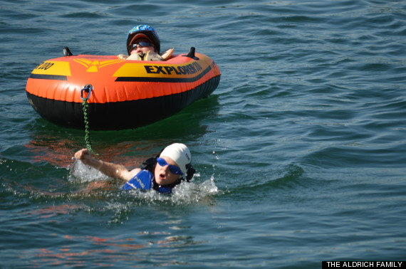 boy-carry-his-disabled-younger-brother-through-triathlon