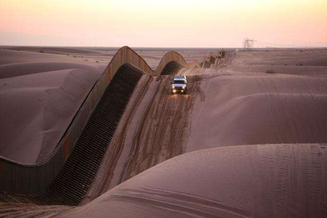 Algodones Sand Dunes Curvy Border Fence in Southern California