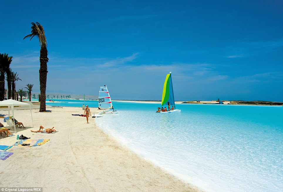 blue water, pristine sand and the world's largest pools man made beach