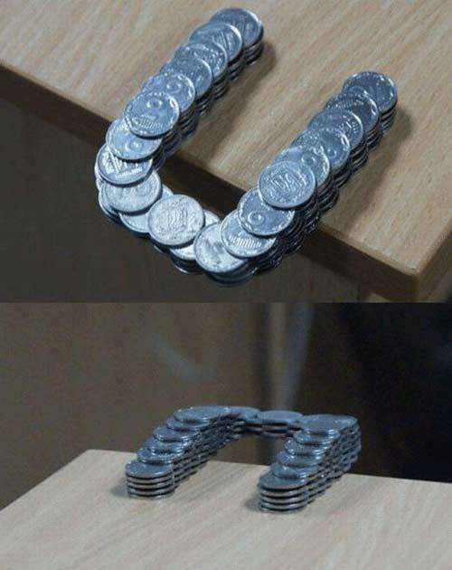 Coins Stacked in Such a Way That They Extend Past the Edge of the Table