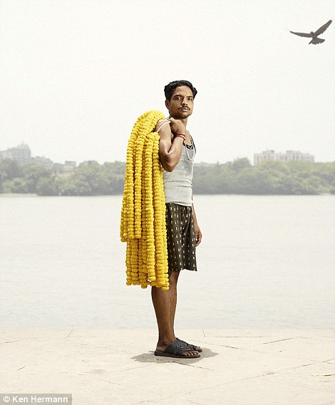 Colourful: A man with a garlands of yellow hibiscus flowers
