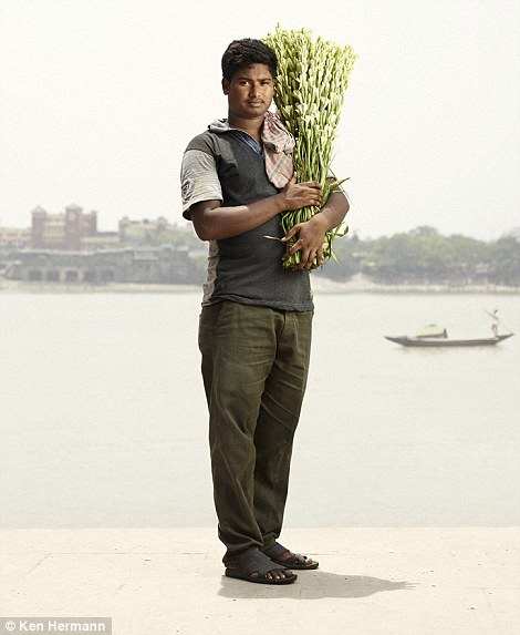 Masculine: A vendor with a bunch of blooms