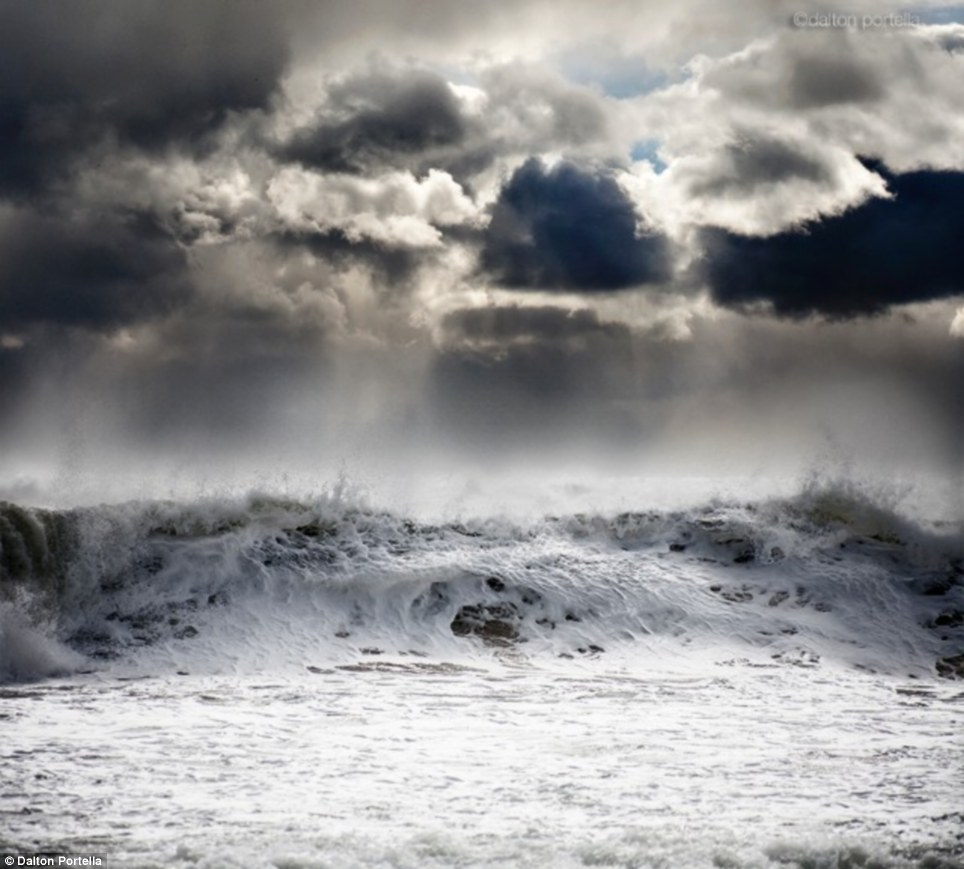Mother Nature at her ferocious moment. photos of thunderstorms churn the ocean by  Dalton Portella