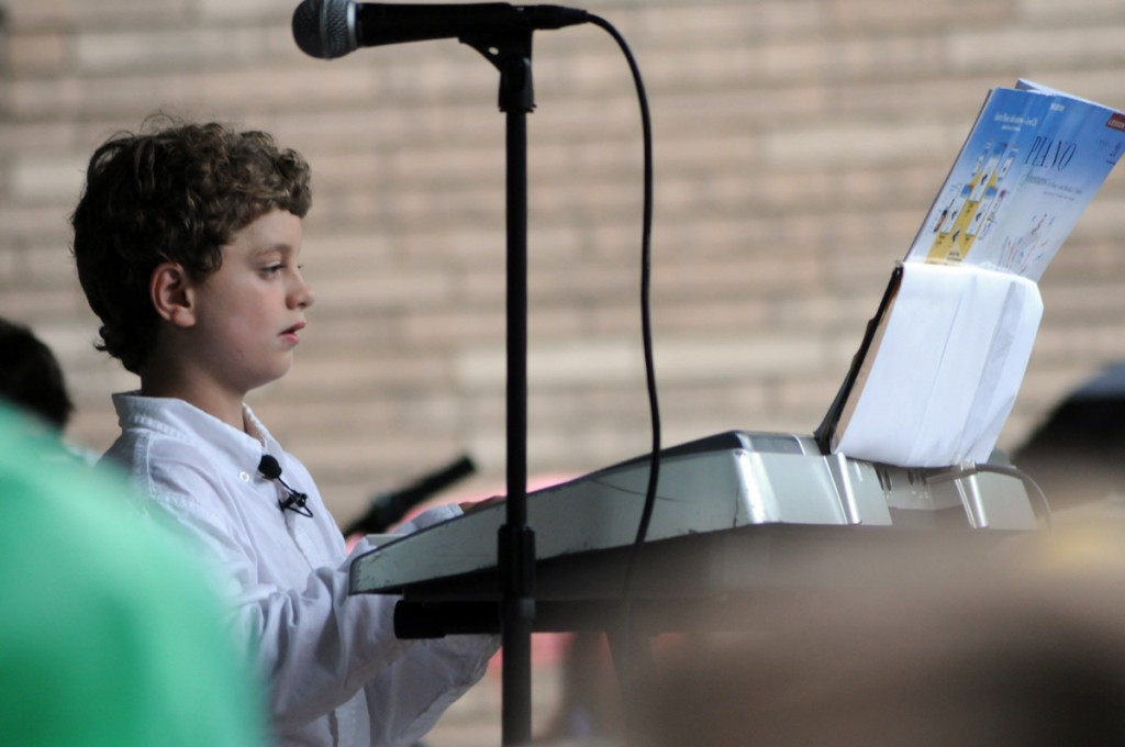 This kid Dylan Sopering  is so lucky! The entire community shows up to his piano recital, he must feel like Beethoven.