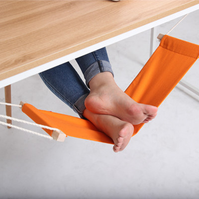 This is genius! These awesome products are so going to make your workday much better! under-the-desk foot hammock