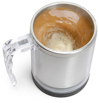 This is genius! These awesome products are so going to make your workday much better! A self-stirring mug.
