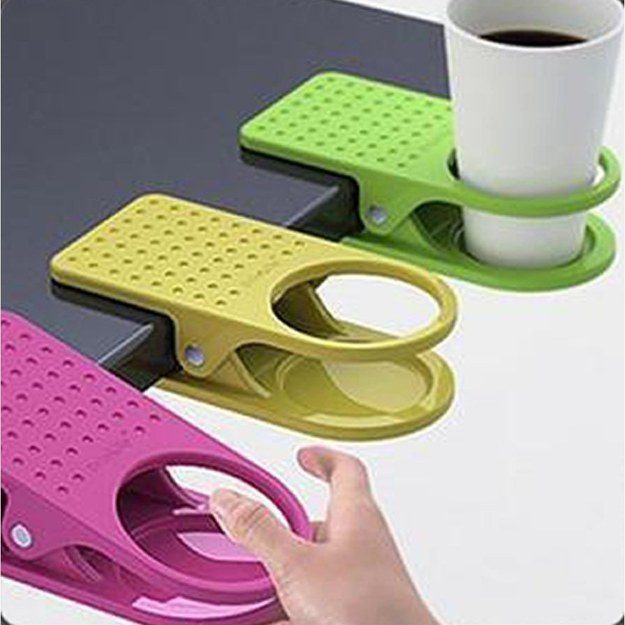 This is genius! These awesome products are so going to make your workday much better! clip that secures a cup holder to your desk