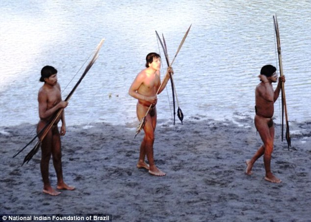 the very moment of natives from Amazonian tribe who were driven away from homes