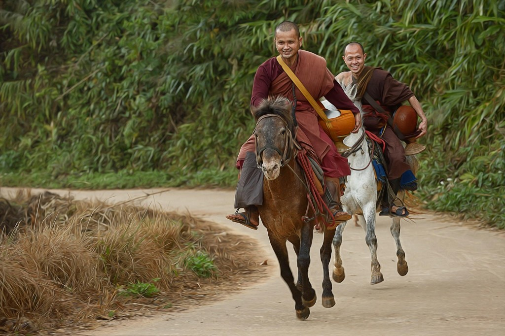 Gorgeous images by Thai photographer Vichaya Pop Riding Monks