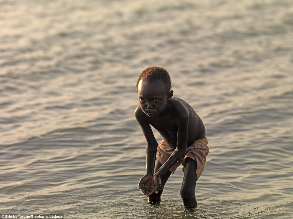 africa's bravest tribe El Molo fights against crocodiles using tiny canoes, and they used to have hippo for dinner