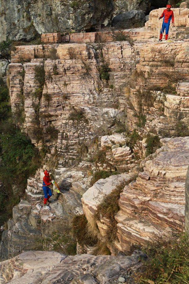 Due to a lack of superpowers (such as web-spinning), these heroes must resort to a more precarious method of climbing, using only some rope and the natural foot-holds on the cliffside.