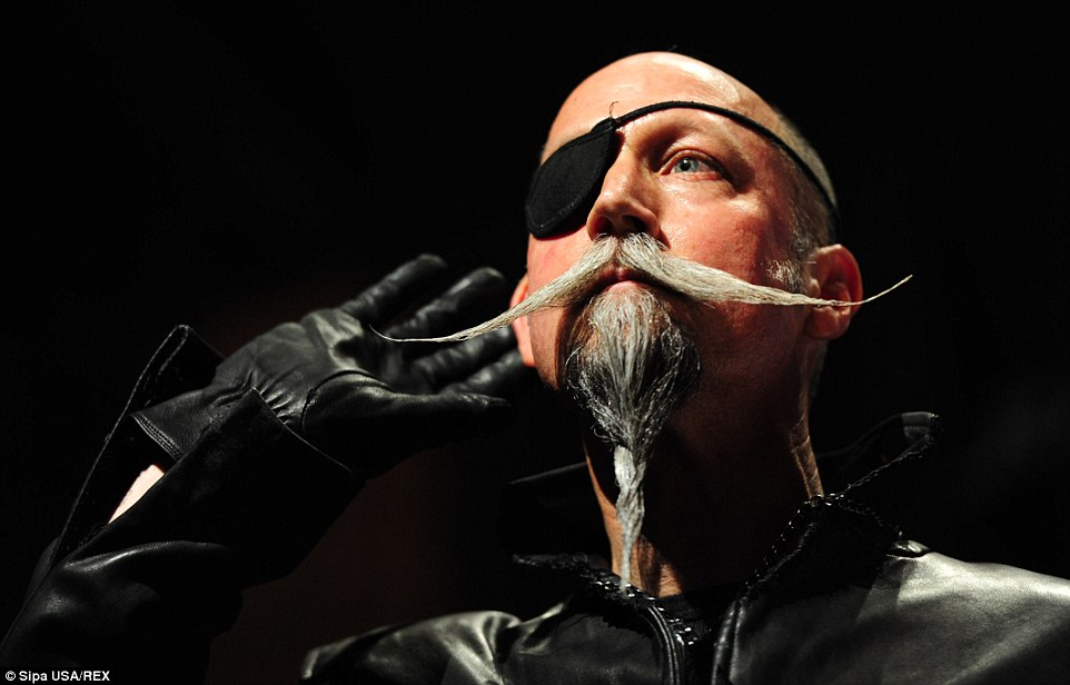 Competitor Al Underwood plays up to the audience with his musketeer style facial hair at the Championships yesterday
