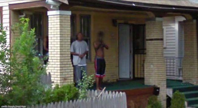 18.) Just a guy pointing a shotgun at the Google Street View van.