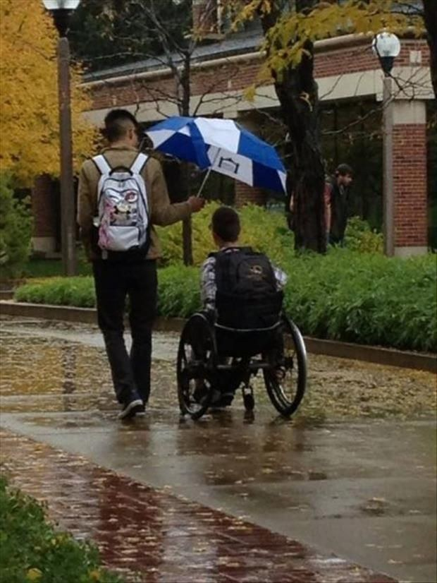 This guy lending a hand during a rainstorm: