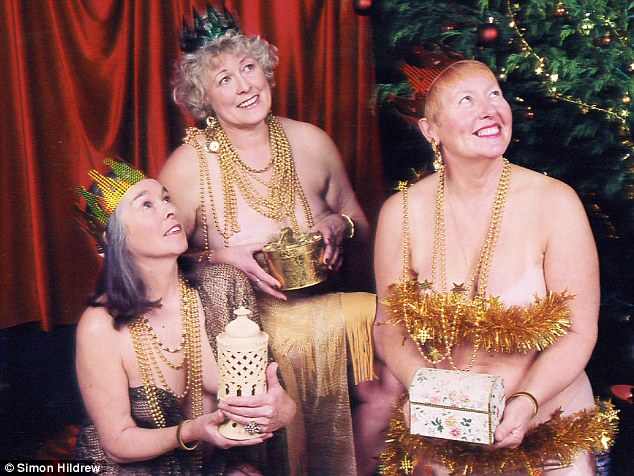 Miss Stevens (centre) appeared as one of the three wise men for a calendar, with a gold gift covering her chest