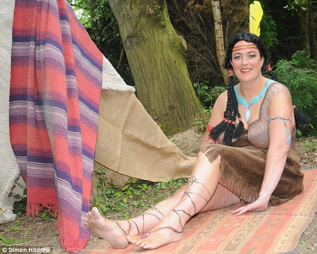 Mr Farage's half sister Melanie Thomas (pictured posing as Pocahontas in 2009), 43, does not shy away from nudity either