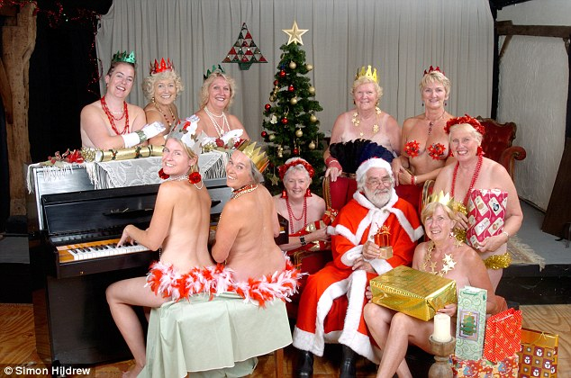 In 2007 Miss Stevens stood naked behind a piano (centre) while fellow WI members surrounded Father Christmas