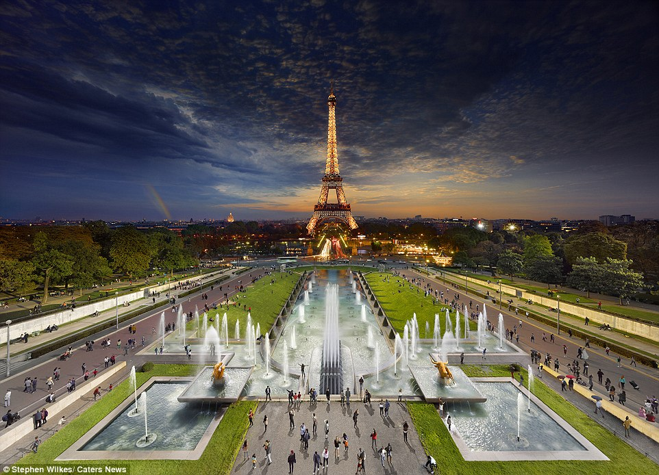 The Eiffel Tower in Paris: Shimmering lights at night while tourists take pictures in the daytime