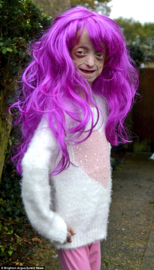Ashanti Elliott Smith, 11, was forced to remove her bright pink wig by a teacher at her school in West Sussex