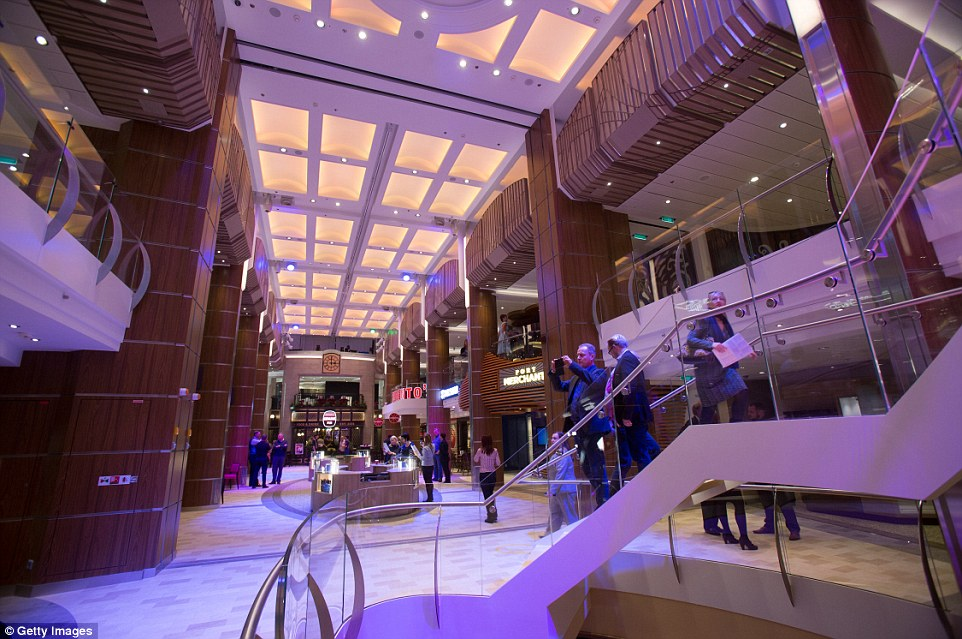 The central part of the cruise ship is filled with shops and 18 restaurants and bars to keep passengers entertained on board