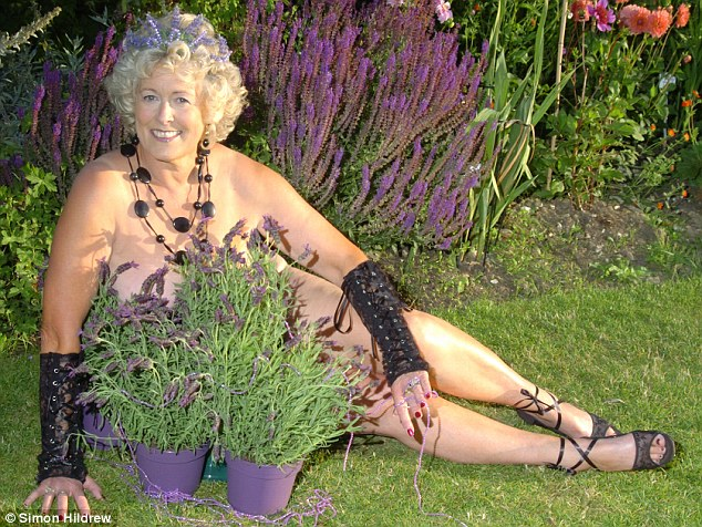 Lavender lover: A rather daring Miss Stevens does a spot of gardening as she poses almost completely naked for a Women's Institute calendar