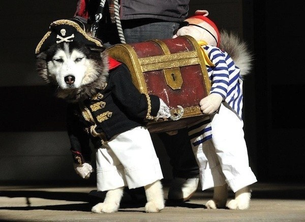 Two Pirates Carrying A Treasure Chest